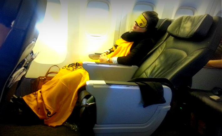 the full, utmost resting position you can get in Fly Scoot's Scoot Biz class. Definitely Not a lie-flat seat