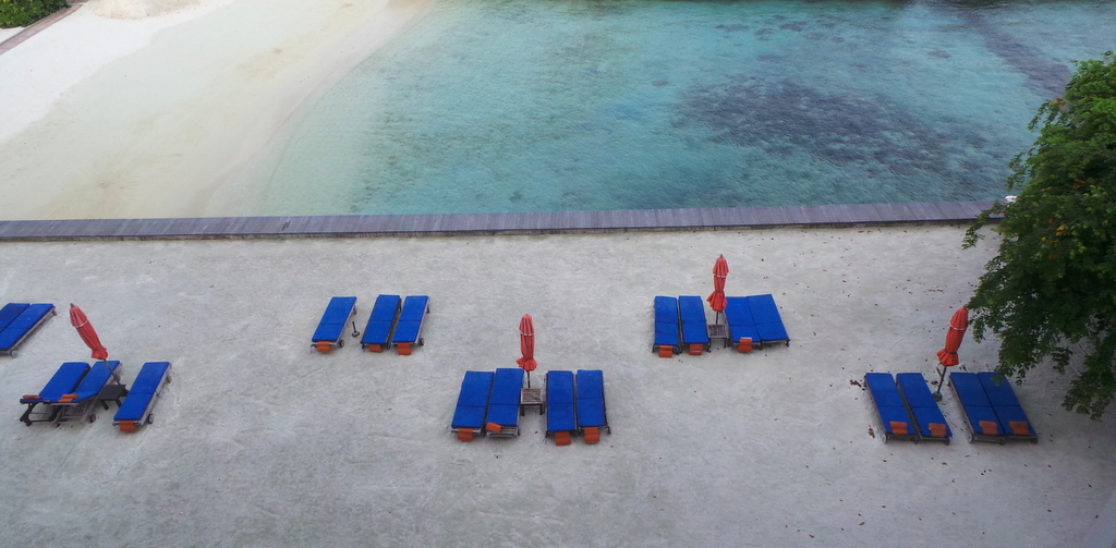sun lounges getting ready for the sunny day ahead. Hulhule Island Hotel