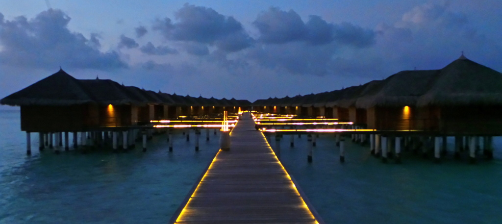 The water villas of Maafushivaru at night