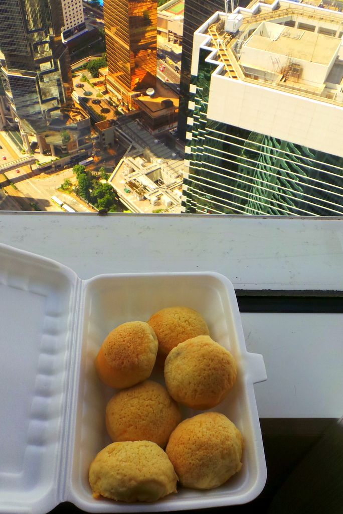 enjoying our takeaway baked BBQ buns at the hotel
