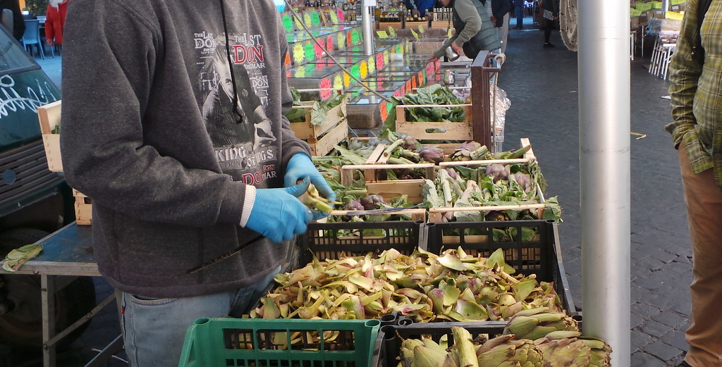 Artichoke being sliced by a local vendor. Walks of Italy Rome Food Tour