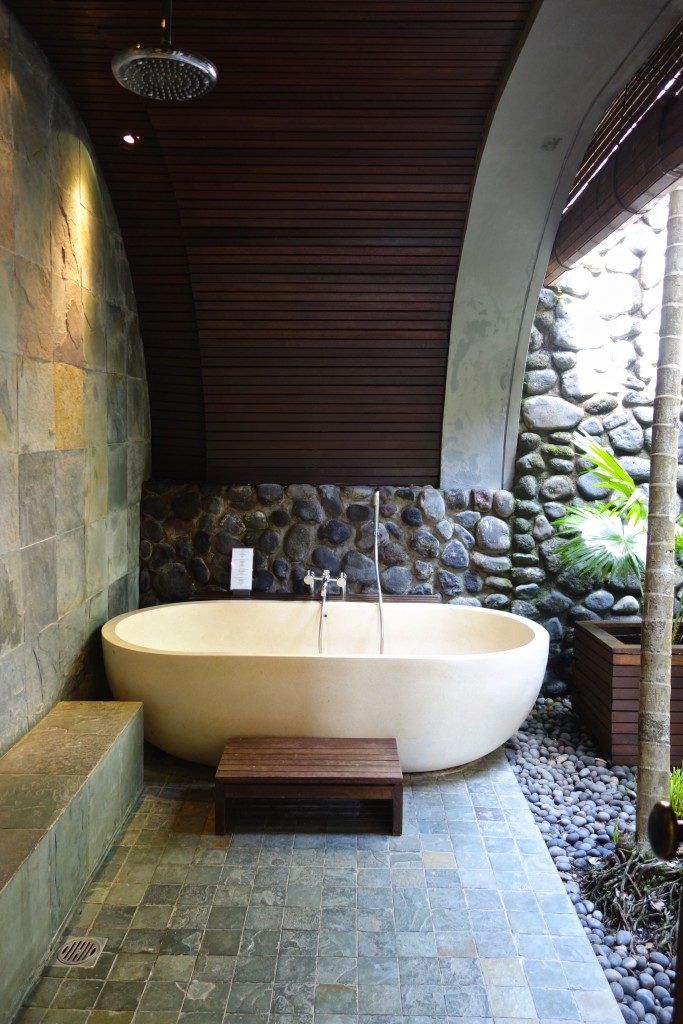 semi-outdoor bath , deluxe room at Alila Ubud Bali