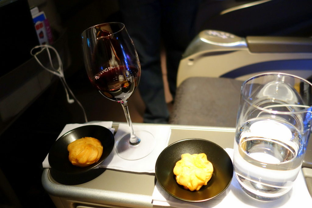 Champagne and cream puffs. After take-off. Garuda Indonesia GA 714 Denpasar to Sydney Business Class