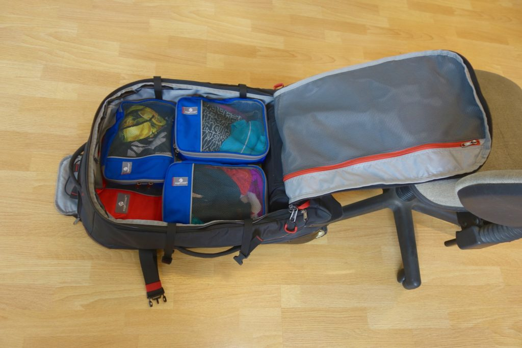 How to Pack with Packing Cubes: Medium Sized cubes go on top of the bigger ones