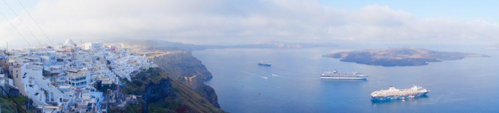 2 cruise ships (Celebrity Cruises and Azamara Cruises) tendered close by to Santorini