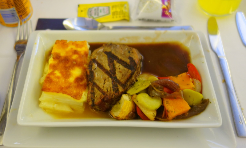 Grilled fillet of Australian grass-fed beef with red wine balsamic sauce, potato & cheddar au gratin & mxed vegetables