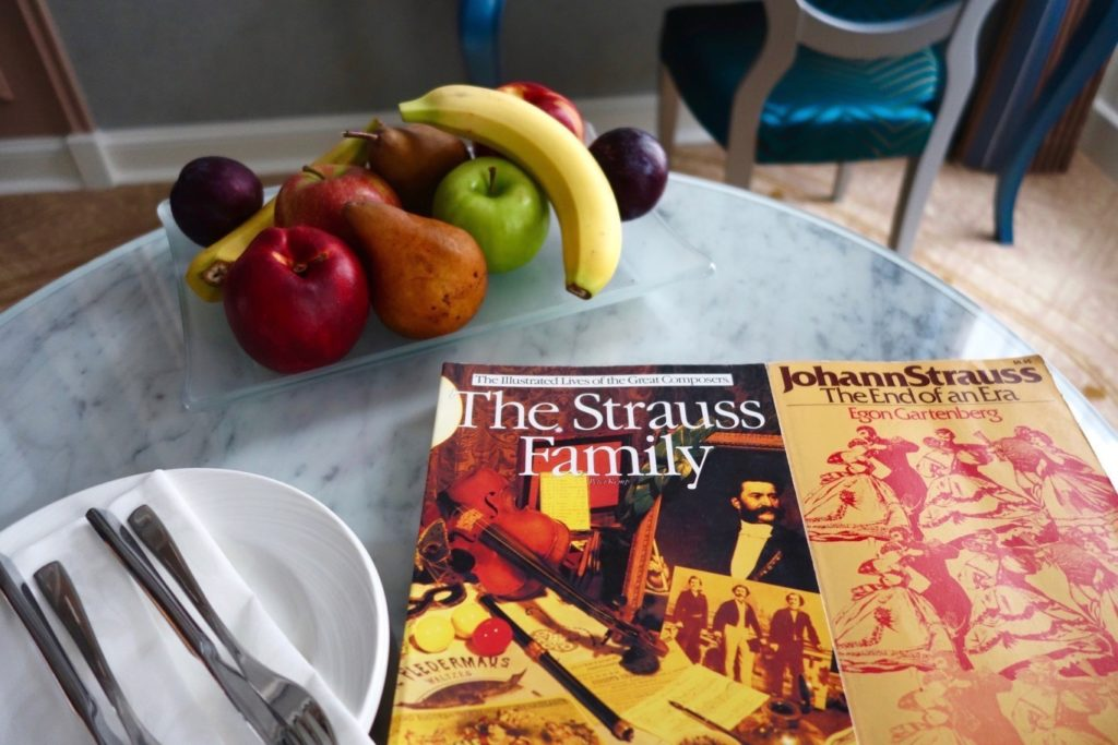 Reading material and fruits at the Johann Strauss Room at Aria Hotel Budapest