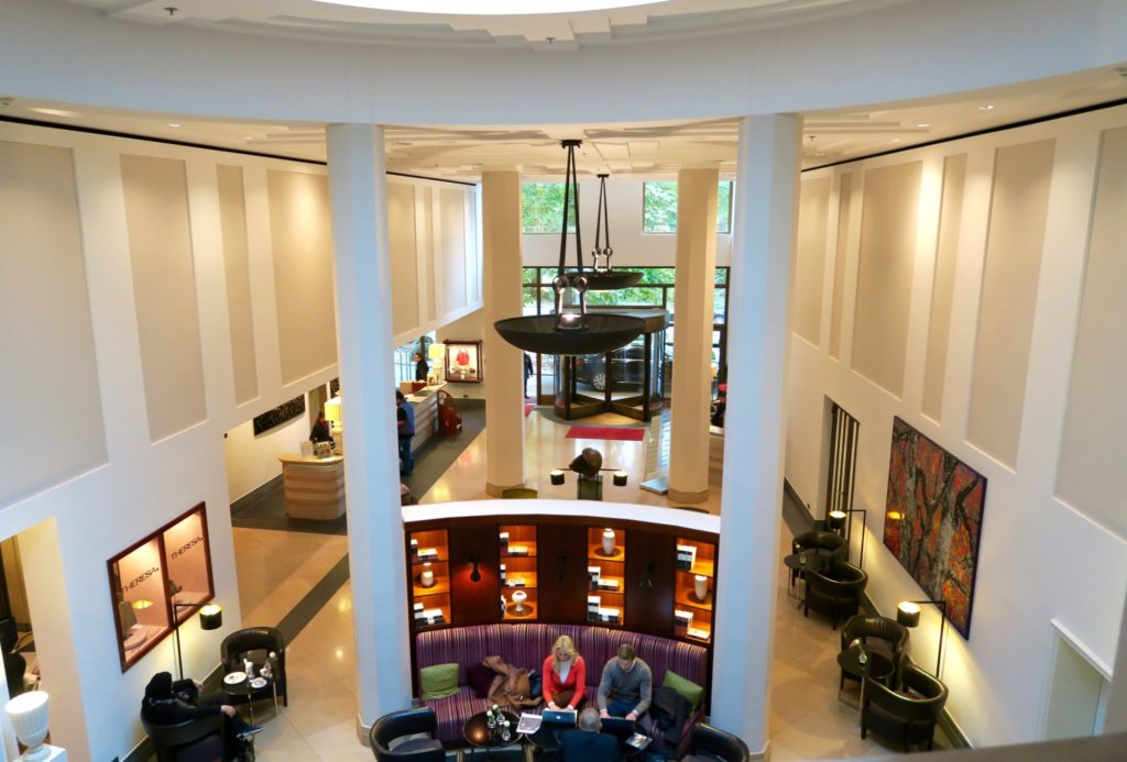 A shot taken above the bar area, lobby and check-in area of The Charles Hotel Munich