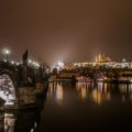 View of Charles Bridge and Prague Castle at night