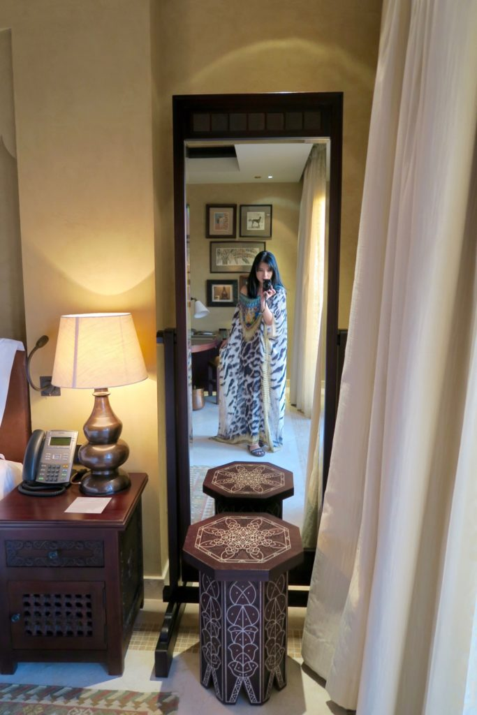 The full-length mirror next to the bed and sliding doors. One-bedroom villa with private pool at Qasr al Sarab by Anantara