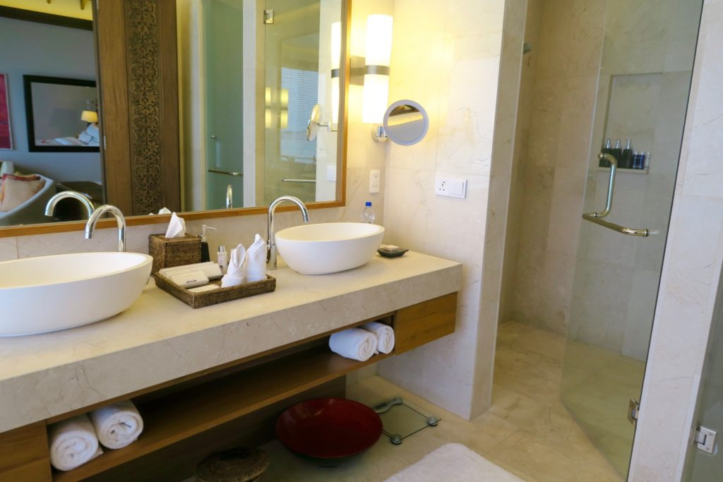 The bathroom in a Deluxe Overwater Pool Bungalow at Anantara Veli Maldives