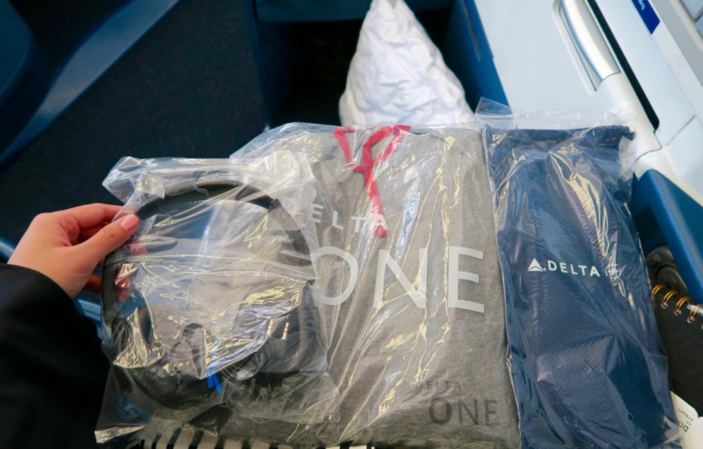 Delta One Amenities - Headphones, Pajamas, and Slippers