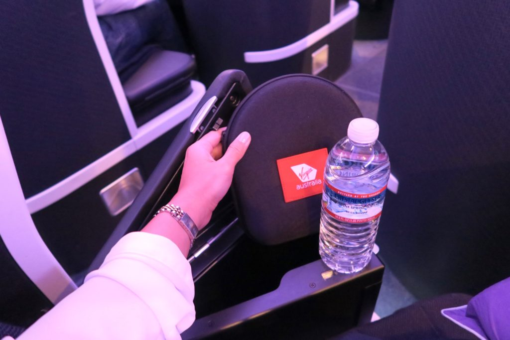 Armrest that also contains headphones and a water bottle. The New Virgin Australia Business Class Suites B777-300