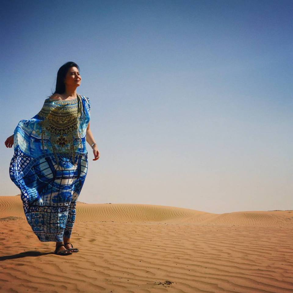 Camilla Round Neck Kaftan - worn in a desert in the Middle East