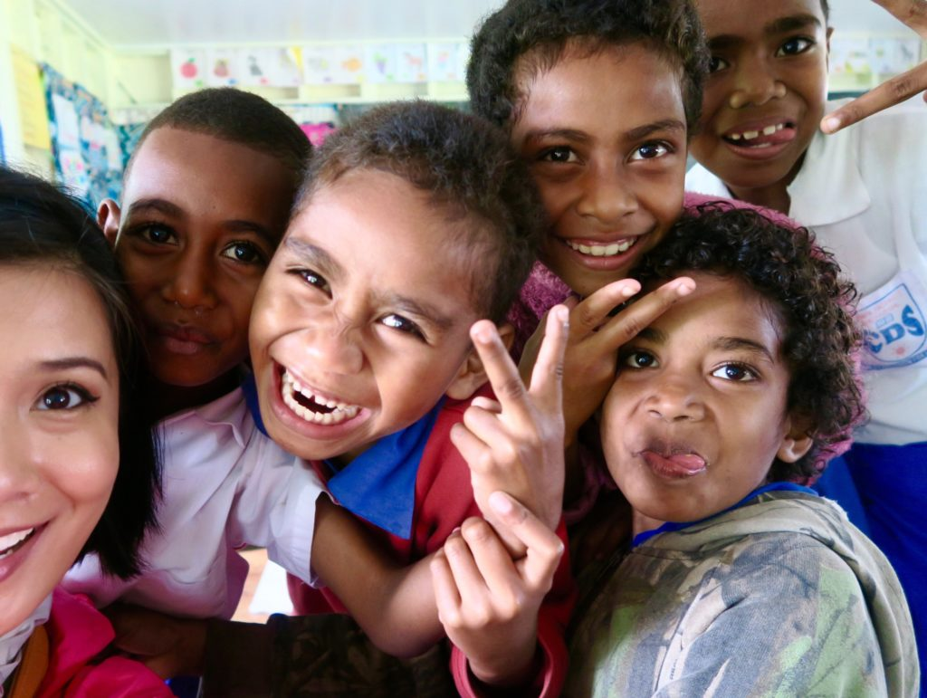 There is no way you cannot smile when you see this photo. Happy Fijian kids!