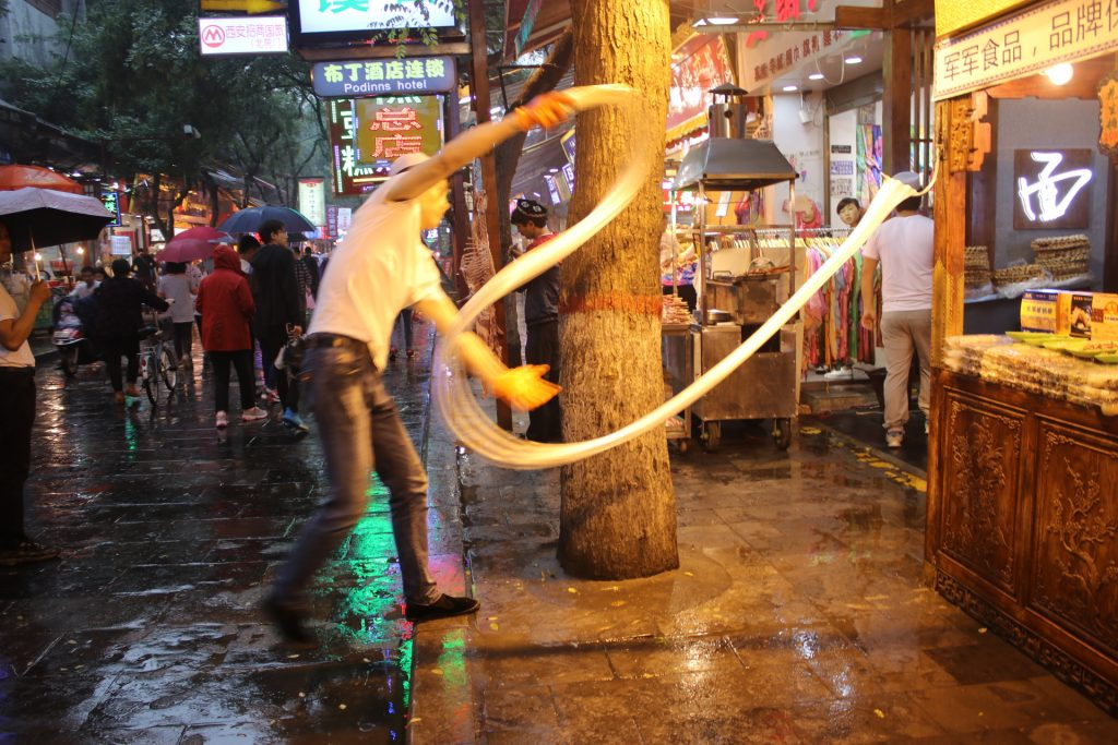 hand pulled noodles in the making at the Muslim Quarter in Xian