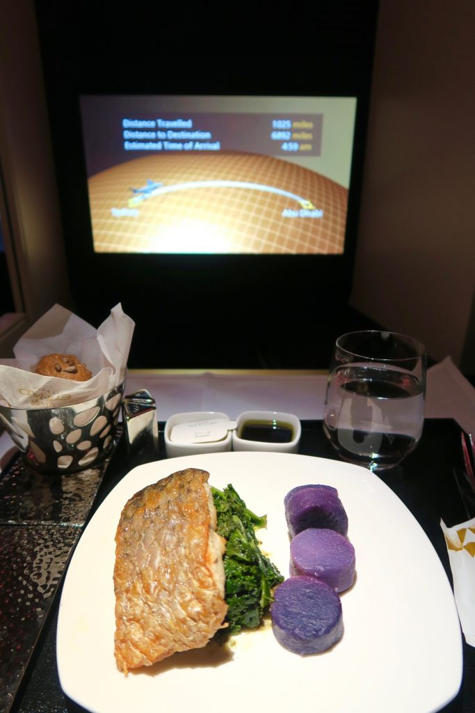 Pan Fried Barramundi with sliced purple potatoes, sauteed kale and caper butter from Etihad Airways Menu EY 455 Sydney to Abu Dhabi Business Class A380