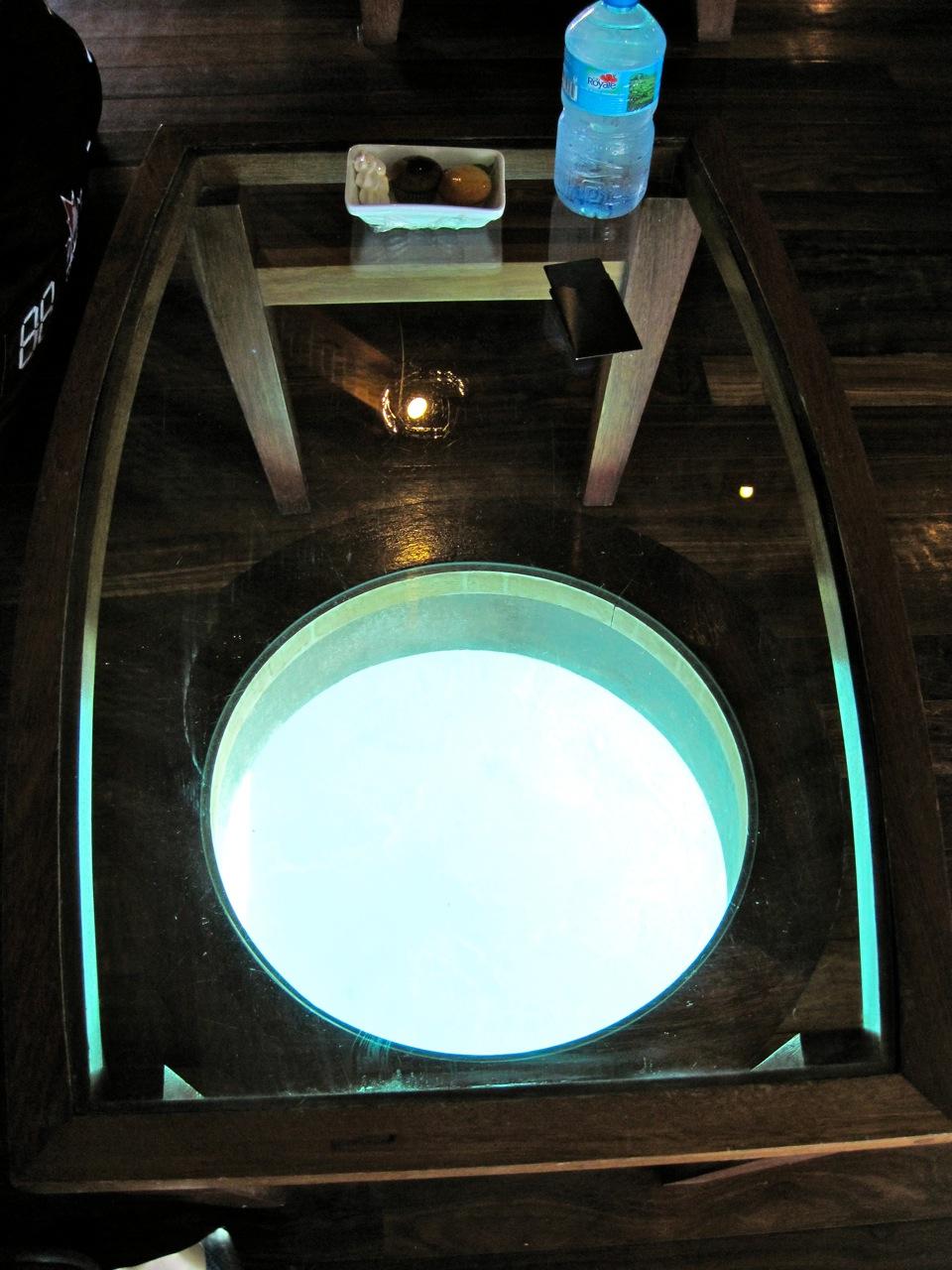 glasstop table at the overwater bungalow Sofitel Bora Bora Private Island