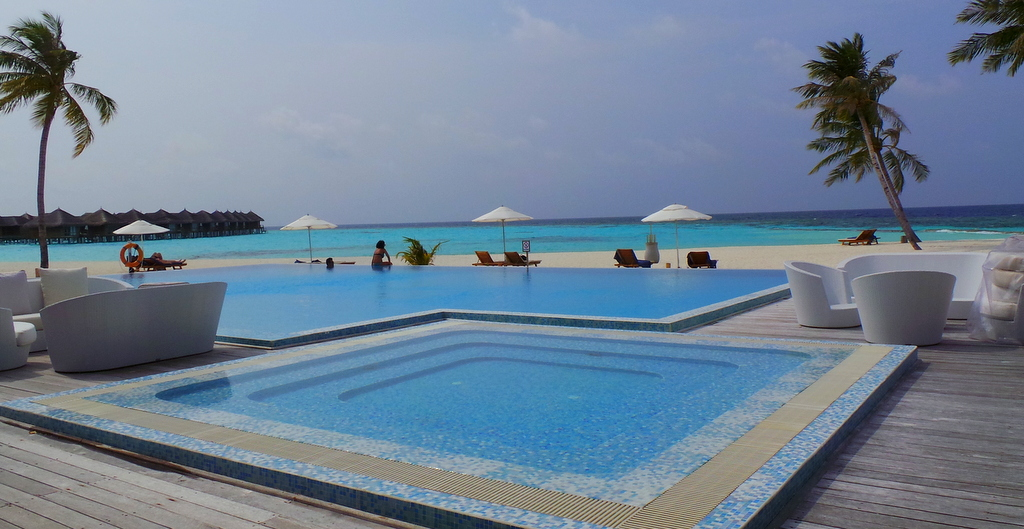 Beachside and pool in Maafushivaru Maldives