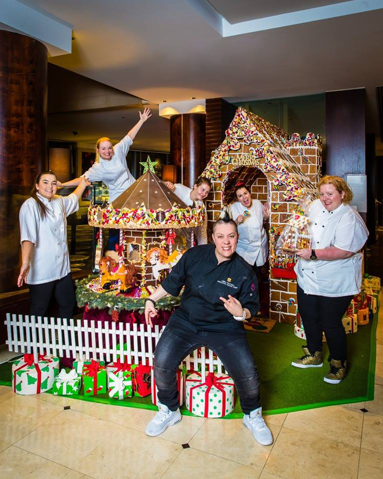 Shangri-la Sydney's Exec. Pastry Chef Anna Polyviou and her team with their Gingerbread House. Photo from Shangri-la Sydney